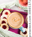 Mug of coffee cookies and flowers 30665371