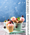 Home made strawberry ice cream served in cones 30665385