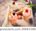 Home made strawberry ice cream served in cones 30665388