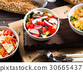 Colorful vegetable salad bowl 30665437