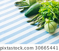 Green vegetables on table cloth 30665441