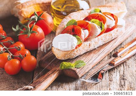 Caprese sandwiches with pesto 30665815