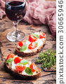 Crostini appetizers with cherry tomatoes, and 30665946