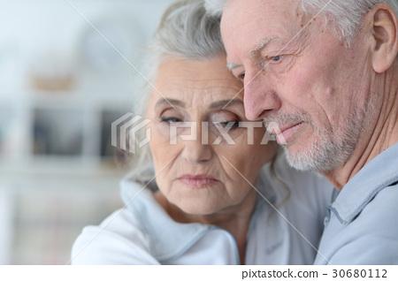 Beautiful sad elderly couple 30680112