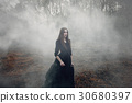 Young attractive Witch walking on the field 30680397