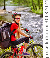 Bicycle teen with ladies bikes in summer park 30682024