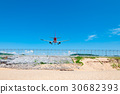 Two jet engine airplane landing runway back view 30682393