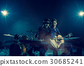 Musician duo band singing a song and playing music instrument with Fellow band musicians on black background with spot light and lens flare, musical concept 30685241