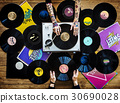 Hands holding music vinyl collectible record 30690028