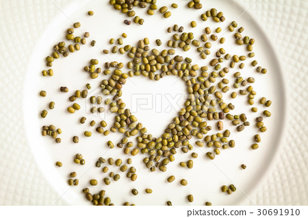 Mung beans in a shape of heart isolated on white 30691910