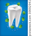 white tooth with fresh mint leaf and water drops 30692941