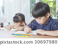 two little kids are doing homework with pencil. 30697980