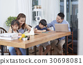 father and mother are helping kids to do their homework. 30698081