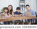 parents are tutoring for their kids. 30698084