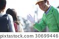 Safety assistance at senior volunteer school road 30699446
