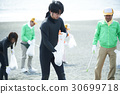 Senior volunteers and surfers to clean the beach 30699718