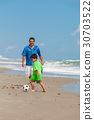 Father Boy Child Playing Soccer Football on Beach 30703522