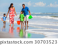 Mother Father Parents Boy Children Family on Beach 30703523