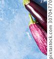 Eggplants on blue textured background 30704770