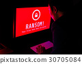 Computer screen with ransomware attack encrypted  30705084