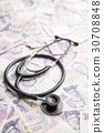 Stethoscope on money background. 30708848
