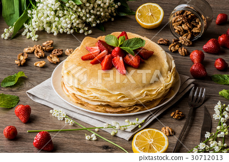 delicious pancakes on wooden table with fruits 30712013