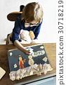 Children having fun with snowman artwork 30718219