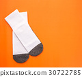 New white student sock on orange background with free space for design 30722785