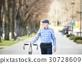 Senior man in blue checked shirt with bicycle in 30728609