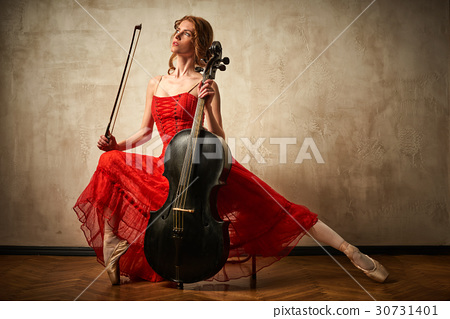 Female ballet dancer playing cello 30731401