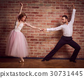 Female ballet dancer learning latin dance with male partner 30731445