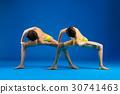 Two young beautiful women doing yoga  30741463