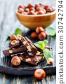 Dark chocolate with hazelnuts and mint leaves. 30742794