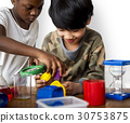 Students studying scientific experiment research 30753875
