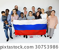 Group of people holding russian flag studio portrait 30753986