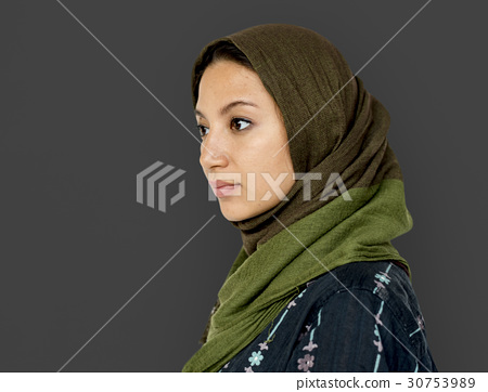 Middle eastern woman casual studio portrait 30753989