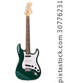 Beautiful green electric guitar isolated 30776231