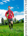 Nordic walking of a man in spring in the meadow 30777638