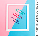 Big paper clips on a vibrant background 30782157