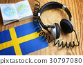 course language headphone and flag on a table 30797080