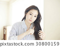 lady is brushing her long hair in the morning 30800159