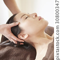 Hands is massaging by pressing point on head. 30800347
