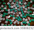 Mahjong tiles on darkwood table background 30808232