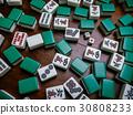 Mahjong tiles on darkwood table background 30808233
