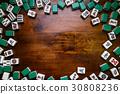 Mahjong tiles on darkwood table background 30808236