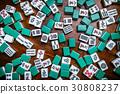 Mahjong tiles on darkwood table background 30808237