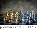 Abstract chess game face to face on a chessboard 30819717
