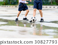Boys in black shoe play football 30827793