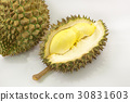 Durian on a white plate with green spike rind 30831603
