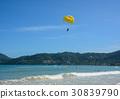 People playing parasailing in Phuket, Thailand 30839790